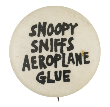 Snoopy Sniffs Aeroplane Glue Humorous Button Museum